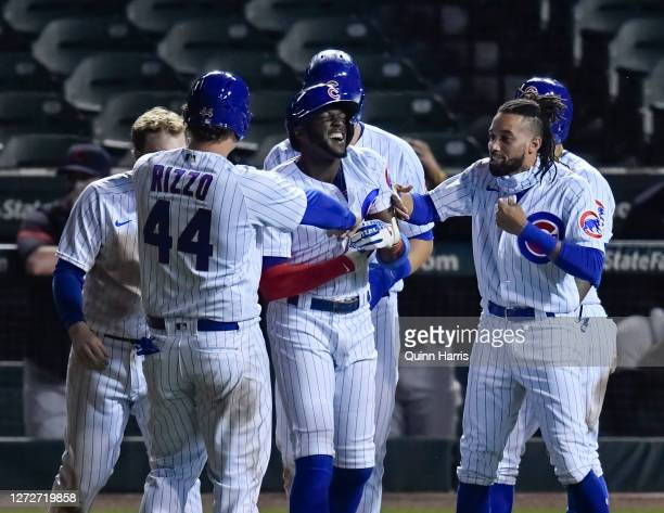 Cameron Maybin of the Chicago Cubs celebrates with teammates after his walkoff hit by pitch in the ninth inning against the Cleveland Indians at...