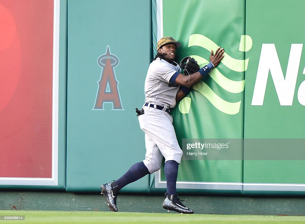 Cameron Maybin #4 of the Detroit Tigers makes a catch at the wall for an out of Kole Calhoun #56 of the Los Angeles Angels during the fourth inning at Angel Stadium of Anaheim on May 30, 2016 in Anaheim, California.