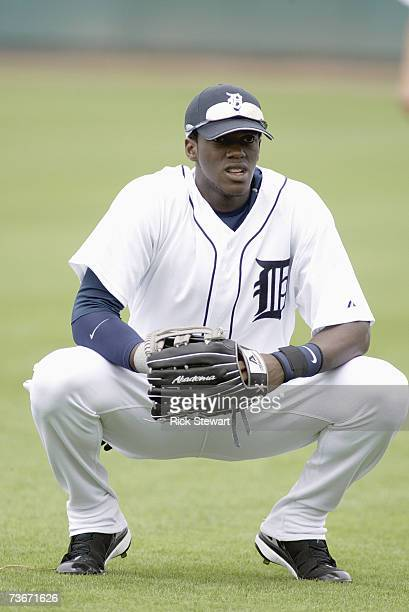 Cameron Maybin of the Detroit Tigers squats down on the field during a Spring Training game against the Cleveland Indians on March 32007 at Joker...
