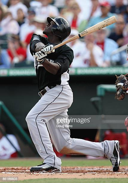 Cameron Maybin of the Florida Marlins bats against the St Louis Cardinals during a spring training game at Roger Dean Stadium on February 25 2009 in...