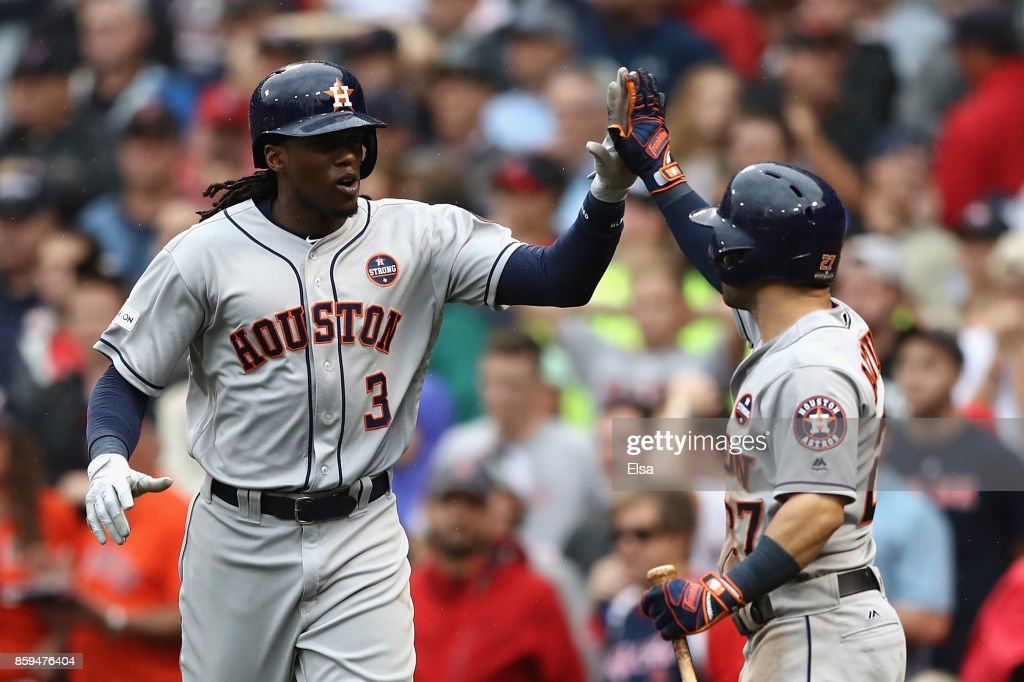Cameron Maybin #3 of the Houston Astros celebrates with Jose Altuve #27 after scoring a run in the eighth inning against the Boston Red Sox during game four of the American League Division Series at Fenway Park on October 9, 2017 in Boston, Massachusetts.