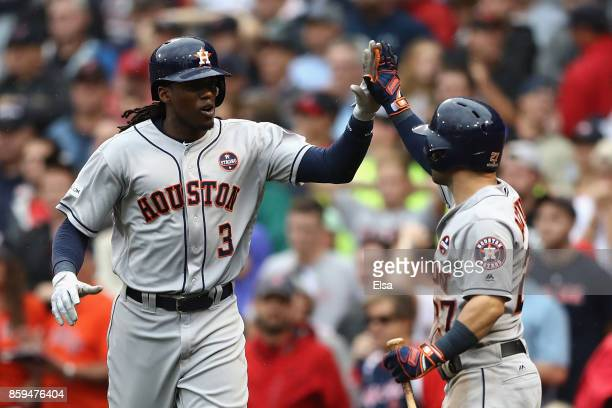 Cameron Maybin of the Houston Astros celebrates with Jose Altuve after scoring a run in the eighth inning against the Boston Red Sox during game four...