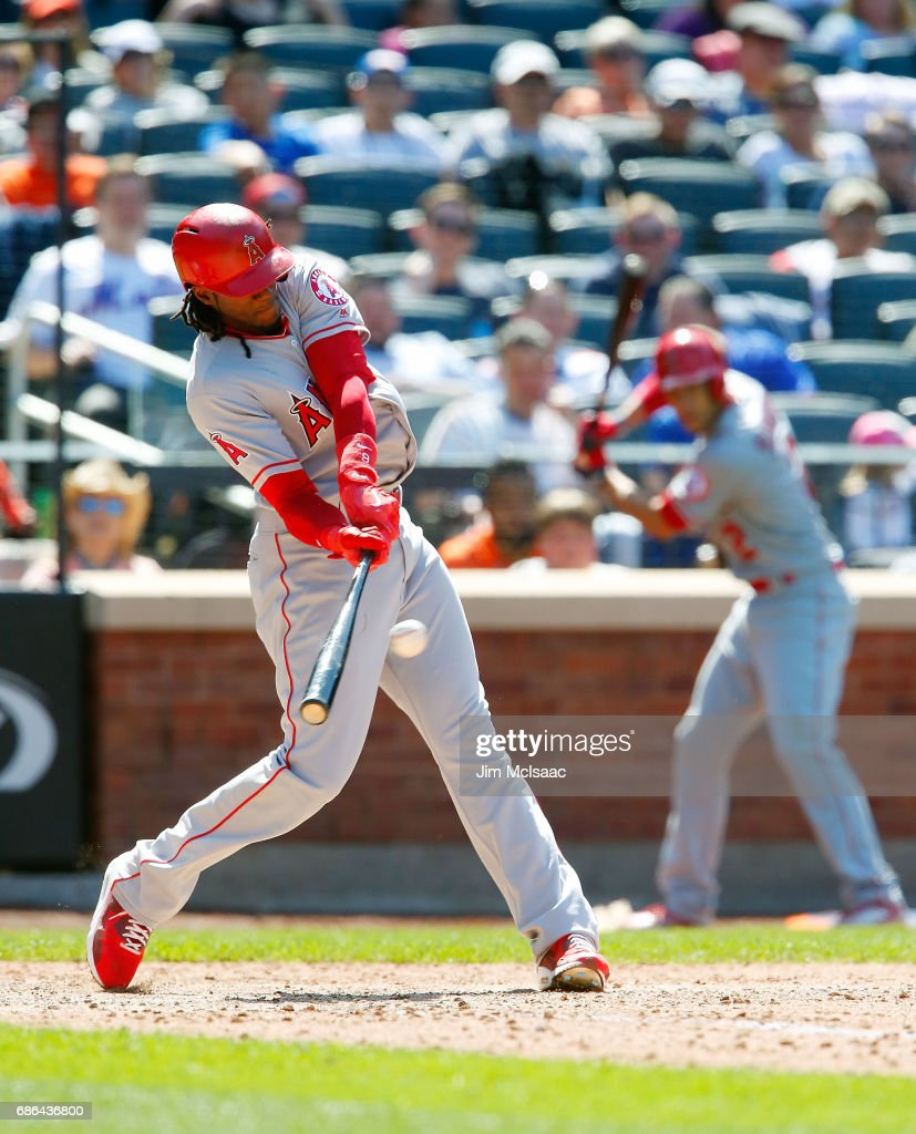Cameron Maybin #9 of the Los Angeles Angels of Anaheim connects on a seventh inning double against the New York Mets at Citi Field on May 21, 2017 in the Flushing neighborhood of the Queens borough of New York City.