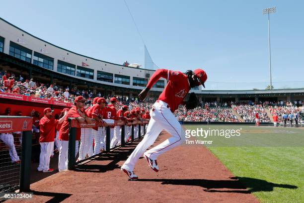 Cameron Maybin of the Los Angeles Angels of Anaheim takes the field in the first inning during a spring training game against the Seattle Mariners at...