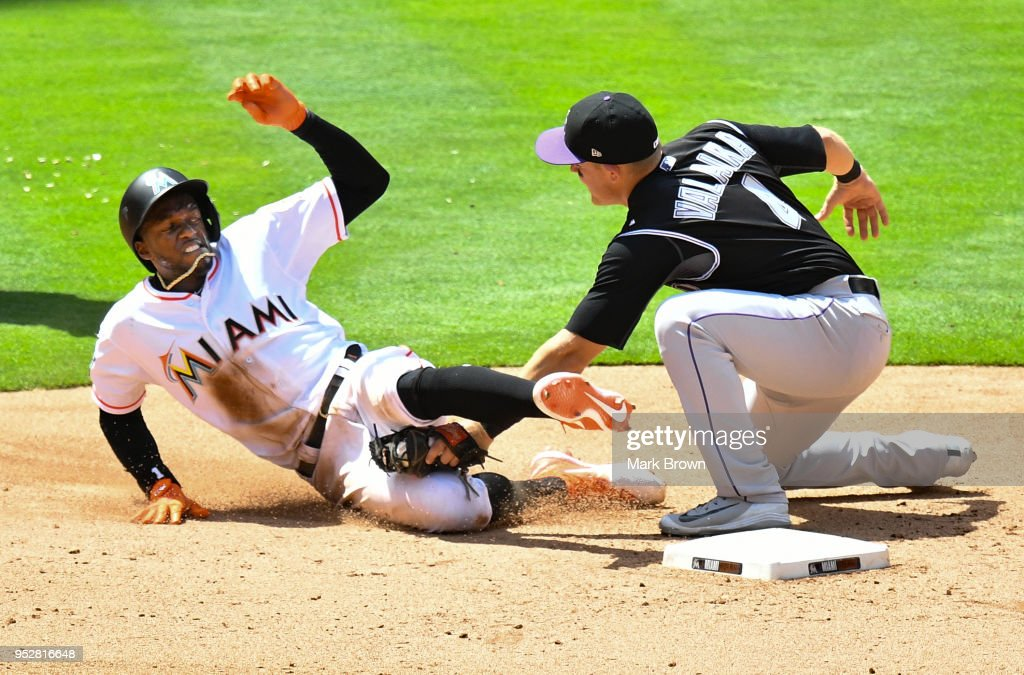 Cameron Maybin #1 of the Miami Marlins is tagged out at second in the seventh inning against the Colorado Rockies at Marlins Park on April 29, 2018 in Miami, Florida.