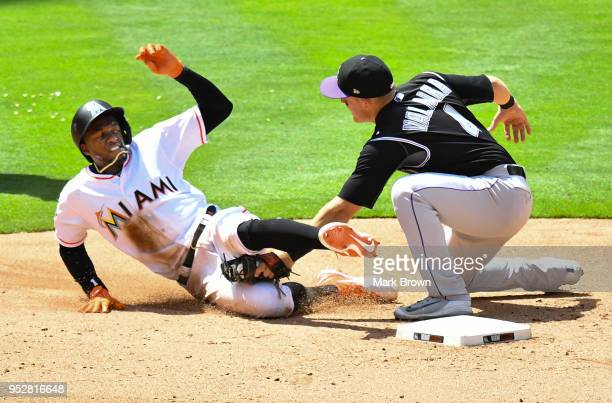 Cameron Maybin of the Miami Marlins is tagged out at second in the seventh inning against the Colorado Rockies at Marlins Park on April 29 2018 in...