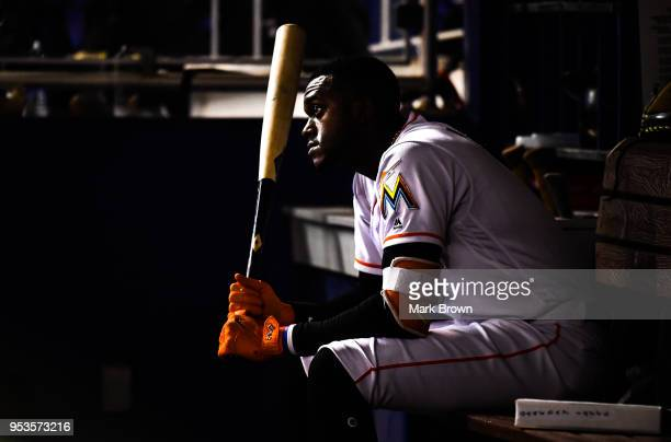 Cameron Maybin of the Miami Marlins waits in the dugout to bat in the tenth inning against the Philadelphia Phillies at Marlins Park on May 1 2018 in...