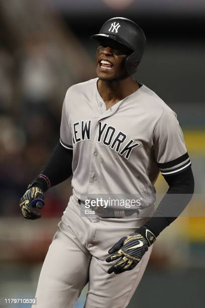 Cameron Maybin of the New York Yankees celebrates his one run home run against the Minnesota Twins in the ninth inning in game three of the American...