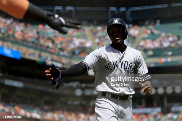 Cameron Maybin of the New York Yankees celebrates scoring during the third inning against the San Francisco Giants at Oracle Park on April 27, 2019...