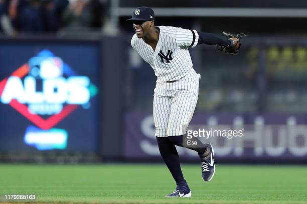 Cameron Maybin of the New York Yankees celebrates their 82 win over the Minnesota Twins in game two of the American League Division Series at Yankee...