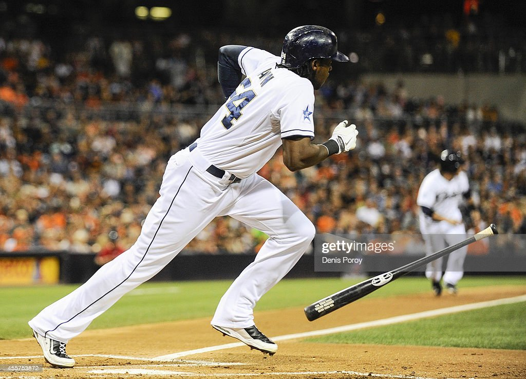 Cameron Maybin #24 of the San Diego Padres hits an RBI single during the first inning of a baseball game against the San Francisco Giants at Petco Park September, 19, 2014 in San Diego, California.