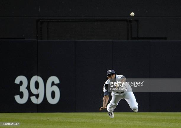 Cameron Maybin of the San Diego Padres makes a diving catch on a ball hit by Gaby Sanchez of the Miami Marlins during the first inning of a baseball...
