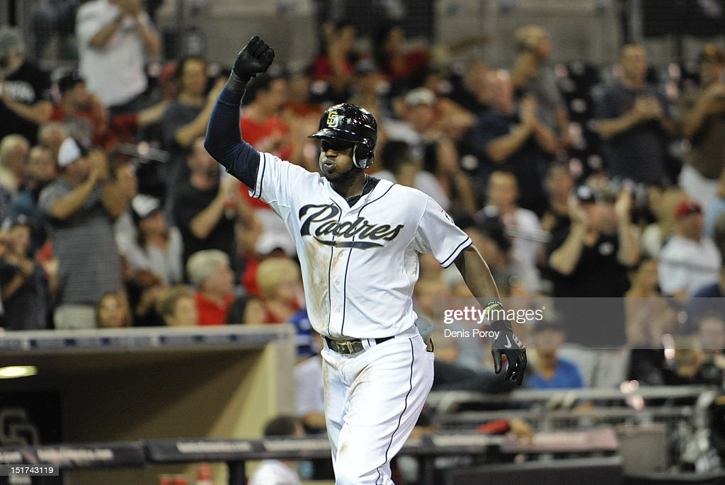 Cameron Maybin #24 of the San Diego Padres pumps his fist as he rounds the bases after hitting a two-run homer during the third inning of a baseball game against the St. Louis Cardinals at Petco Park on September 10, 2012 in San Diego, California.