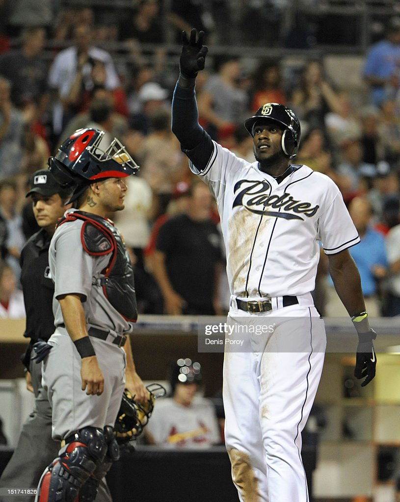Cameron Maybin #24 of the San Diego Padres waves to fans after hitting a two-run homer as Yadier Molina #4 of the St. Louis Cardinals looks on during the third inning of a baseball game at Petco Park on September 10, 2012 in San Diego, California.