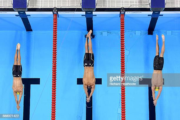 Cameron McEvoy of Australia Nathan Adrian of the United States and Kyle Chalmers of Australia compete in the Men's 100m Freestyle Final on Day 5 of...