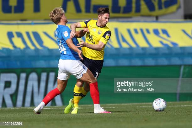 Cameron McGeehan of Portsmouth and James Henry of Oxford United during the Sky Bet League One Play Off Semifinal 2nd Leg match between Oxford United...