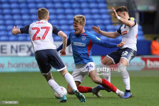 Cameron McGeehan of Portsmouth FC is fouled by Dennis Politic of Bolton Wanderers during the Sky Bet League 1 match between Bolton Wanderers and...