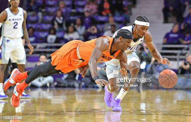 Cameron McGriff of the Oklahoma State Cowboys dives after a loose ball against Xavier Sneed of the Kansas State Wildcats during the first half at...