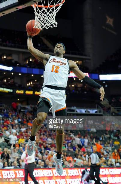 Cameron McGriff of the Oklahoma State Cowboys dunks against the Iowa State Cyclones in the first half during the first round of the Big 12 Basketball...