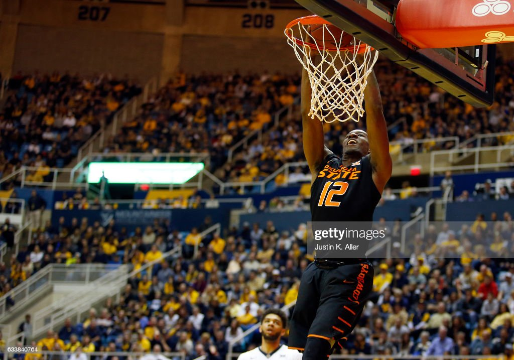 Cameron McGriff #12 of the Oklahoma State Cowboys dunks the ball against the West Virginia Mountaineers at the WVU Coliseum on February 4, 2017 in Morgantown, West Virginia.