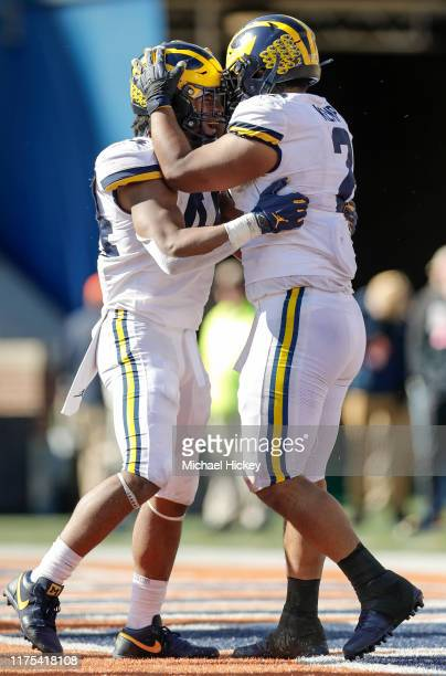 Cameron McGrone of the Michigan Wolverines celebrates with Carlo Kemp of the Michigan Wolverines during the second half against the Illinois Fighting...