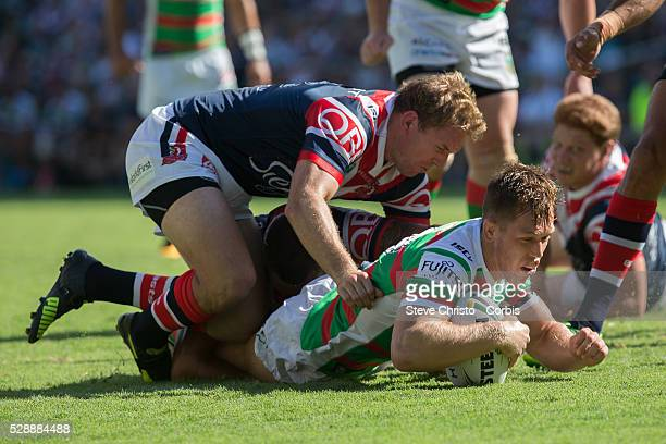 Cameron McInnes of the Rabbitohs scores the first try against the Roosters during the match between the Sydney Roosters and the South Sydney...