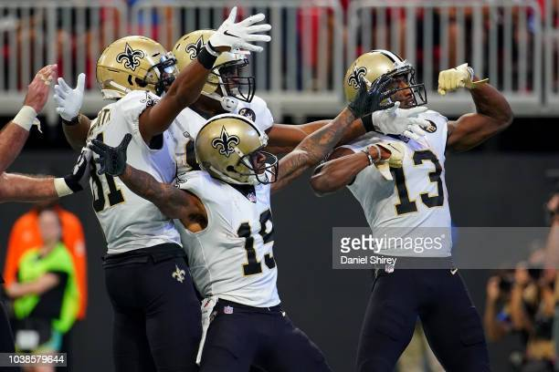 Cameron Meredith of the New Orleans Saints celebrates a touchdown with teammates during the third quarter against the Atlanta Falcons at MercedesBenz...