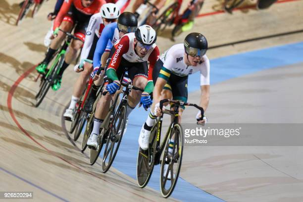 Cameron Meyer of Australia and Joao Matias of Portugal compete during the men's points race final during the UCI Track Cycling World Championships in...