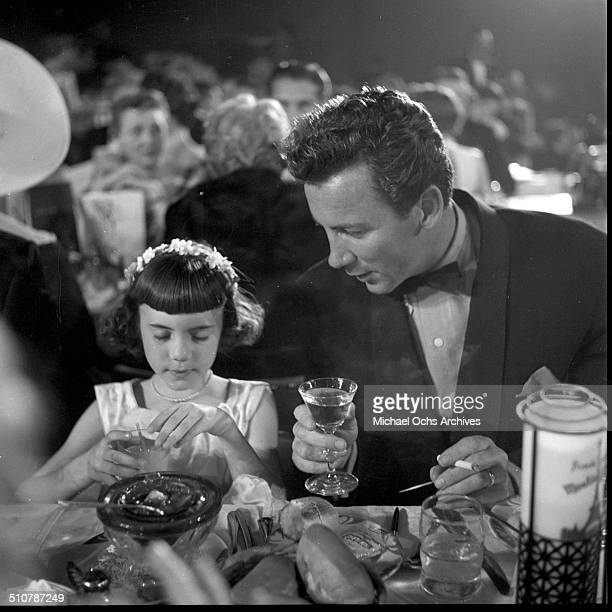 Cameron Mitchell sits with Melinda Marx Groucho Marx's daughter during the Emmy Awards in Los AngelesCA