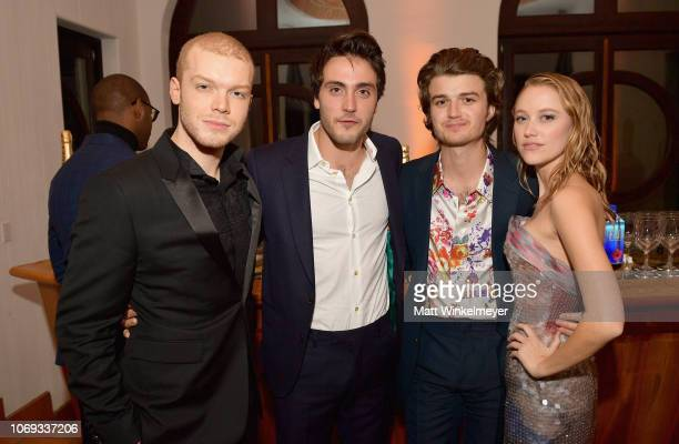 Cameron Monaghan guest Joe Keery and Maika Monroe attend the 2018 GQ Men of the Year Party at a private residence on December 6 2018 in Beverly Hills...