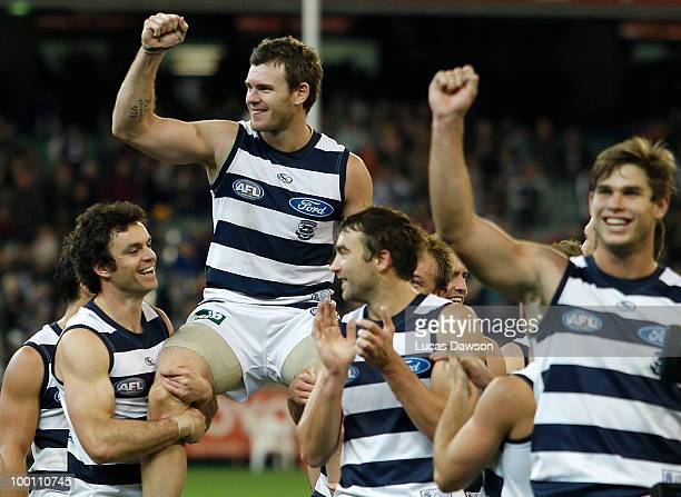 Cameron Mooney of Cats and his team mates leave the ground after the round nine AFL match between the Collingwood Magpies and the Geelong Cats at...