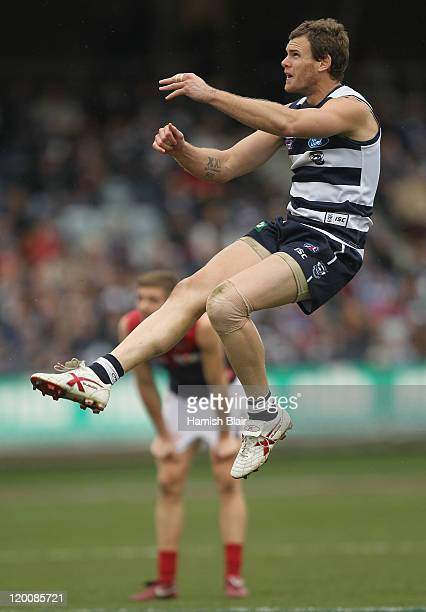 Cameron Mooney of the Cats kicks a goal during the round 19 AFL match between the Geelong Cats and the Melbourne Demons at Skilled Stadium on July 30...