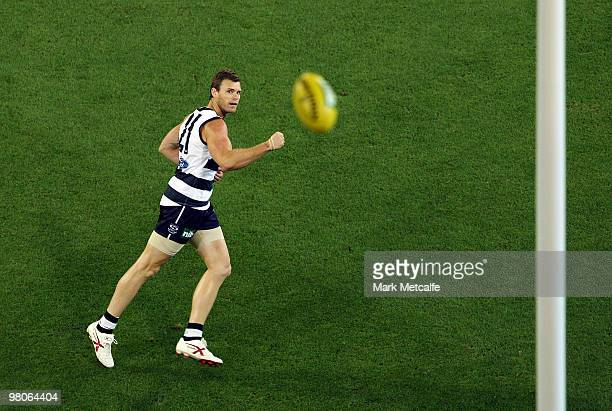 Cameron Mooney of the Cats kicks a goal during the round one AFL match between the Geelong Cats and the Essendon Bombers at Melbourne Cricket Ground...