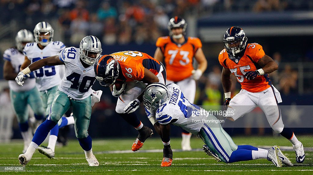 Cameron Morrah #86 of the Denver Broncos is tackled by Jemea Thomas #47 of the Dallas Cowboys and Will Smith #40 of the Dallas Cowboys in the second half of their preseason game at AT&T Stadium on August 28, 2014 in Arlington, Texas.