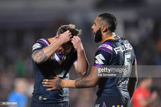 Cameron Munster and Josh AddoCarr of the Storm look dejected after their loss in the round five NRL match between the Wests Tigers and the Melbourne...