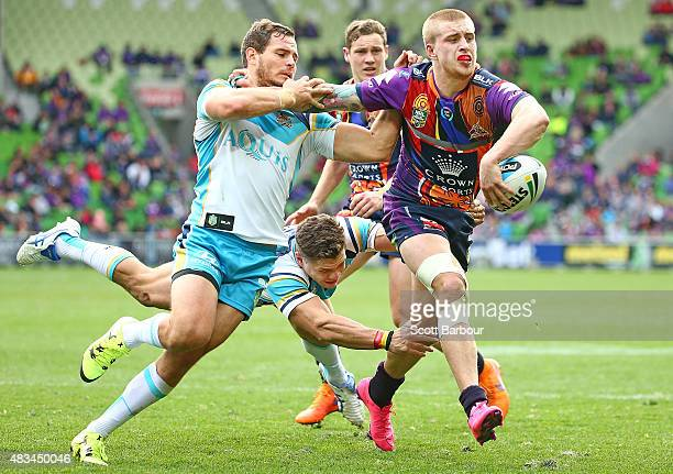 Cameron Munster of the Melbourne Storm is tackled just short of the try line during the round 22 NRL match between the Melbourne Storm and the Gold...