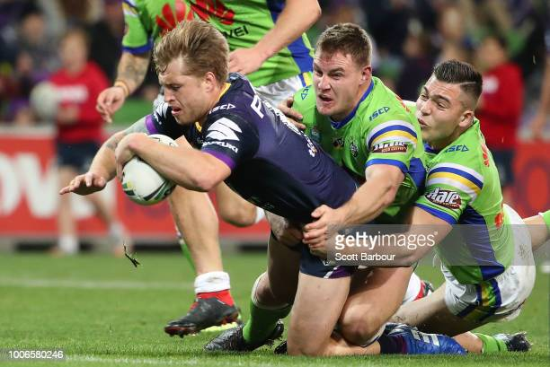 Cameron Munster of the Melbourne Storm runs in to score a try during the round 20 NRL match between the Melbourne Storm and the Canberra Raiders at...