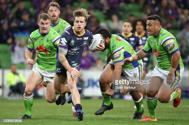 Cameron Munster of the Melbourne Storm scores a try during the round 20 NRL match between the Melbourne Storm and the Canberra Raiders at AAMI Park...