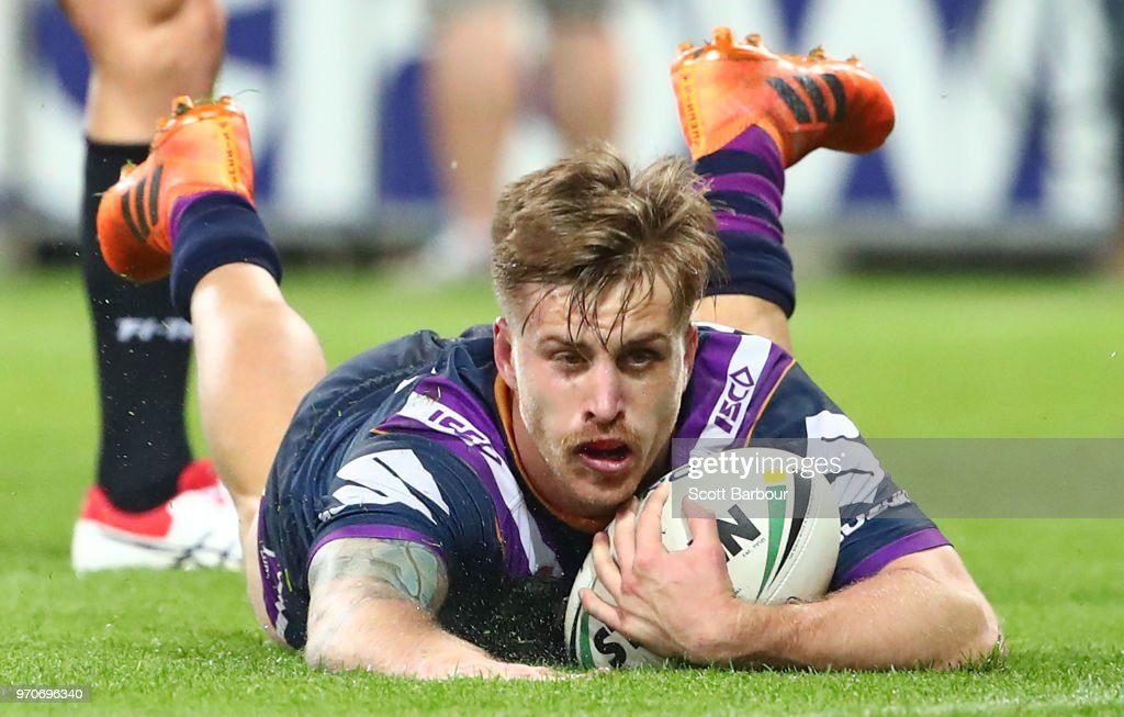 Cameron Munster of the Melbourne Storm scores a try during the round 14 NRL match between the Melbourne Storm and the Brisbane Broncos at AAMI Park on June 10, 2018 in Melbourne, Australia.
