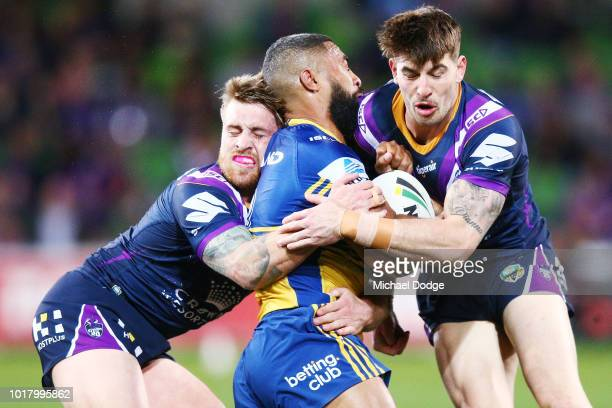 Cameron Munster of the Storm and Curtis Scott tackles Michael Jennings of the Eels during the round 23 NRL match between the Melbourne Storm and the...