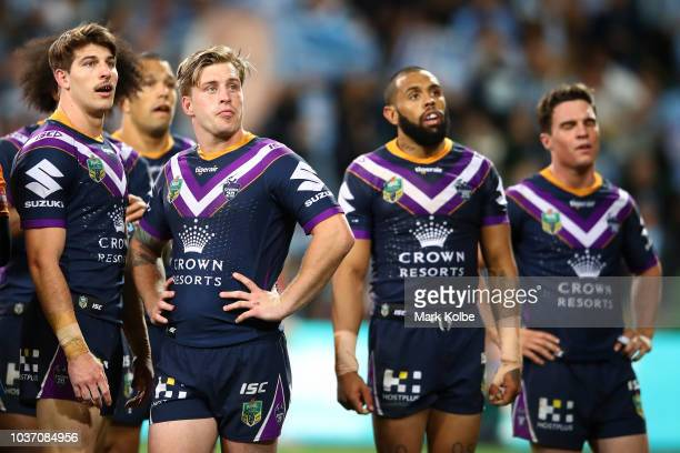 Cameron Munster of the Storm and team mates wait for a referee's decision during the NRL Preliminary Final match between the Melbourne Storm and the...