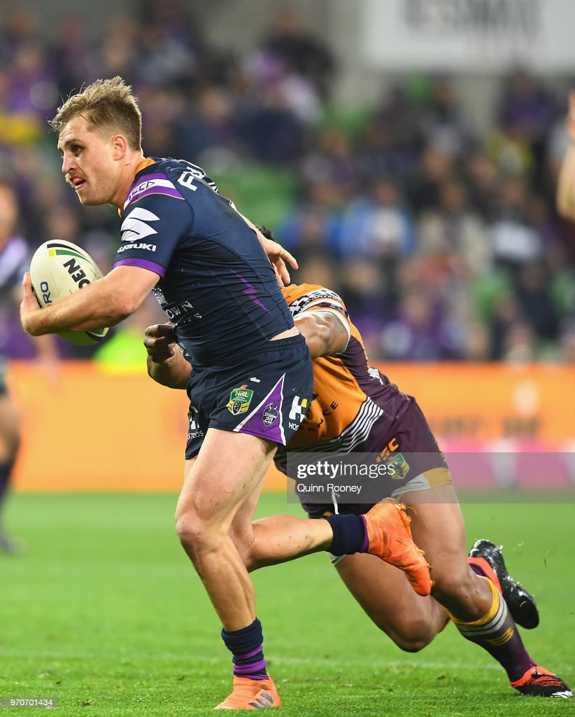 Cameron Munster of the Storm breaks through a tackle during the round 14 NRL match between the Melbourne Storm and the Brisbane Broncos at AAMI Park on June 10, 2018 in Melbourne, Australia.