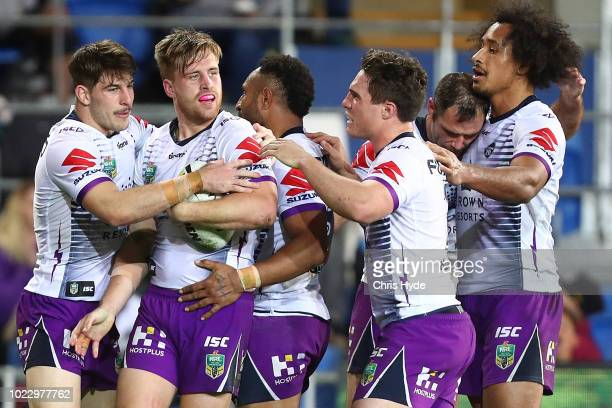 Cameron Munster of the Storm celebrates a try during the round 24 NRL match between the Gold Coast Titans and the Melbourne Storm at Cbus Super...