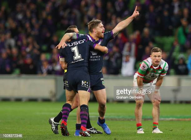Cameron Munster of the Storm celebrates kicking a drop goal during the NRL Qualifying Final match between the Melbourne Storm and the South Sydney...