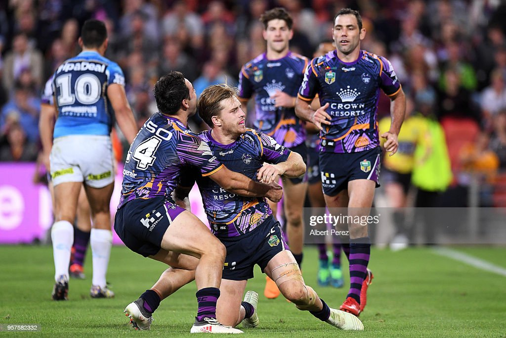 Cameron Munster of the Storm celebrates scoring a try during the round ten NRL match between the Melbourne Storm and the Gold Coast Titans at Suncorp Stadium on May 12, 2018 in Brisbane, Australia.