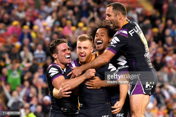 Cameron Munster of the Storm is congratulated by team mates after scoring a try during the round nine NRL match between the Melbourne Storm and the...