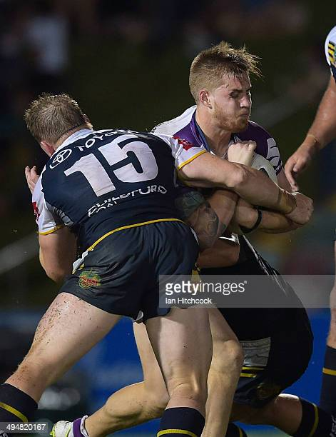 Cameron Munster of the Storm is tackled by Glenn Hall of the Cowboys during the round 12 NRL match between the North Queensland Cowboys and the...