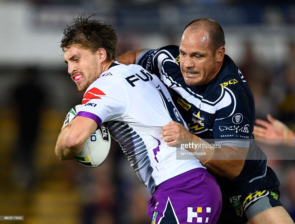 Cameron Munster of the Storm is tackled by Matthew Scott of the Cowboys during the round 12 NRL match between the North Queensland Cowboys and the Melbourne Storm at 1300SMILES Stadium on May 25, 2018 in Townsville, Australia.