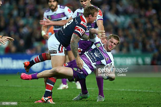 Cameron Munster of the Storm is tackled by the Rooster's Jake Friend during the Qualifying Final match between Sydney Roosters and Melbourne Storm at...