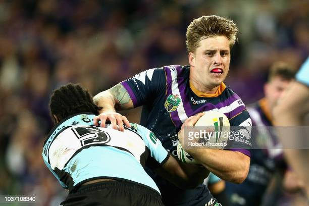 Cameron Munster of the Storm is tackled during the NRL Preliminary Final match between the Melbourne Storm and the Cronulla Sharks at AAMI Park on...